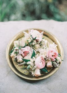 Romantic pink boutonnieres: http://www.stylemepretty.com/tennessee-weddings/nashville/2016/02/15/rainy-day-rustic-elegant-nashville-wedding/ | Photography: Julie Paisley - http://juliepaisleyphotography.com/