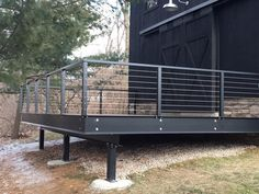 A serious deck wrap that won't rock nor roll, with steel support beams, handrails and posts. #housetrends http://www.ketroncustombuilders.com/