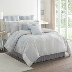 Bring polished elegance to your master suite or guest room with this lovely cotton comforter set, showcasing a textured jacquard design in a blue and silver ...