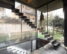 folded steel staircase - suspended by cables