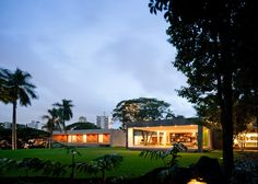 Slideshow: a mysterious orange door on a suburban São Paulo street leads to a dream house and gardens designed byarchitect Isay Weinfeld. The house includes a cinema, wide outdoor patios for entertaining and a swimming pool running the length of the garden. The four boxy shapes that make up the house are each finished ina