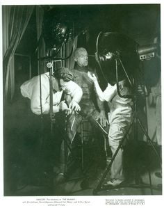 Director Karl Freund and makeup artist Jack Pierce attending to Boris Karloff's…
