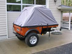 Image of an orange Tentrax Tent Set-Up.
