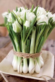 Rustic twine binds green onions and white flowers into a charming centerpiece or gift bouquet Easter Flower Arrangements, Easter Flowers, Floral Arrangements, Easter Centerpiece, Easter Decor, Table Centerpieces, White Tulips, White Flowers, Beautiful Flowers