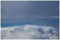 Among the clouds ... - Beautiful landscape of Giumalau mountain peak from Romanian Carpathians mountains in winter seasonn
