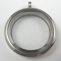 "Floating locket : 1 3/16"" diameter, 3/16"" deep; glass front & back, stainless steel, hinged, magnetic closure.  Different sizes, finishes, & shapes available.   #handmade #jewelry"