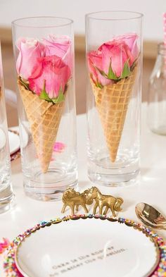 Something so simple, yet playful and elegant. We love the soft pink roses in the sugar cones. Placing them in small vases gives your table a fairytale look that no one can deny. #playful #birthday #fairytale