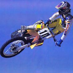 Iron Mike LaRocco flattening out his Factory Suzuki RM250 for Kinney Jones' camera in 1990. #LaRocket #HiPointGear #IfOnlyICouldBuyAStart #Charger #TheRock #BadMoFo #Supercross #Motocross #Zook #ILove90sMoto