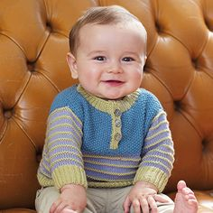 Knit this childrens round neck sweater, a design from the Rowan archive that is now available to purchase online. Designed by Martin Storey using our wonderful soft blend yarn Wool Cotton 4ply (wool and cotton), this pull over has a moss stitch section, stripe details and button neck fastening | English Yarns