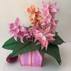 Colorful flowers in paper vase