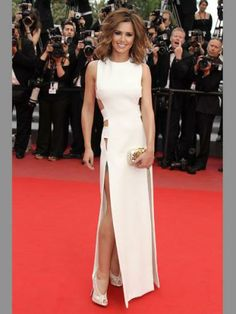 The nations sweetheart knows how to rock a designer outfit. This cut out white Versace dress oozes glamour and demure. Nice work Chezza!