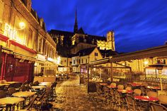 Cathedral and cafes of Amiens - Cathedral of Our Lady of Amiens and the cafes at night. Amiens, Nord-Pas-de-Calais-Picardy, France.