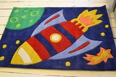 Rocket rug with a large Rocket on a background of comets and stars.