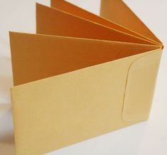 How to Make Envelope Books | Adhere the five envelopes together. You can just stack them and press ...