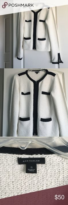 Ann Taylor zip up sweater size small Ann Taylor zip up sweater size small. White with black trim Ann Taylor Sweaters Cardigans