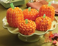 Don't carve – just bite! Covered in orange-colored Jelly Belly jelly beans, these amazing cakes are the spitting images of your favorite autumn gourd. And no seeds to dig out! Credit: whatsnewcupcake (Karen Tack and Alan Richardson, authors of Hello, Cupcake!)