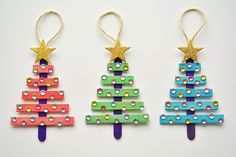These popsicle stick Christmas trees are SO EASY to make and they're so beautiful! The kids LOVED decorating them! Such an awesome Christmas craft idea!!