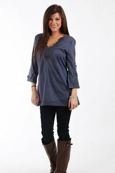 """Hot Lava Top, Navy $51.00  This tunic is great for anyone and everyone! The color is classic, and the design on the sleeves make for an expensive look. This pairs perfectly with denim or colored skinny jeans... just add boots and you're set!   Fits true to size. Miranda is wearing the small.   From shoulder to hem:  Small - 28.5""""  Medium - 29""""  Large - 29.5"""""""