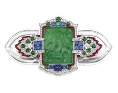 ART DECO CARVED JADE, DIAMOND, SAPPHIRE AND ENAMEL BROOCH, CARTIER, CIRCA 1925
