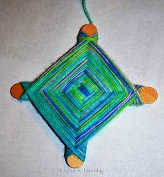 Learn the history behind and make an ojo de dios craft with your kids.