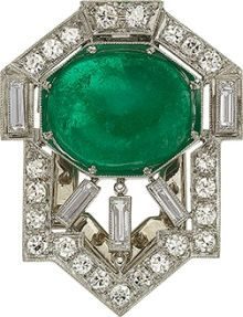 Estate Jewelry:Brooches - Pins, AN ART DECO EMERALD, DIAMOND, PLATINUM CLIP-BROOCH. The broochfeatures a cabochon emerald measuring 12.00 x 10.00 x 4.70 mm...