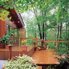 For sloped yards, a multilevel deck gives you the square footage you need without having to use extra-tall posts that require extra bracing. | Photo: Brad Simmons/Esto | thisoldhouse.com