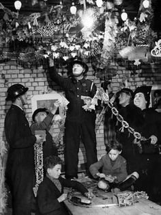 The ARP's wont let Hitler and his bombs deter them from celebrating Christmas, they are seen here decorating an air raid shelter.