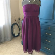JCrew silk dress Good used condition strapless dress in lovely wine color. Back zip, fully lined. There are a few tiny snags but does not affect wear. More pictures upon request. J. Crew Dresses Strapless