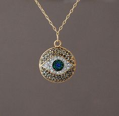 Hey, I found this really awesome Etsy listing at http://www.etsy.com/listing/128280460/gold-evil-eye-pave-crystal-sparkling
