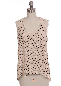 """Break some hearts in the Love Triangle Tank! A small triangular pattern covers this simply structured top making it easy to pair with any skirt or favorite pair of denim duds. Fit is blouse-like. Model is wearing size small. Size small measures 24"""" front length, 28"""" back length, 34"""" bust. 100% Polyester.  $45.00"""