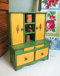 Look what I found! A 1920s child's toy step-back cupboard. Sooooo cute...