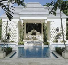 Add to your pavilion décor with ivy that climbs the columns and wire guides of the structure. The greenery adds a tropical appeal to the poolside pavilion while softening the exterior. The area offers protection from the sun, and a simple overhead fan creates an added breeze for those that enjoy a carefree meal under the shade.