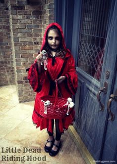 Red cloak or hoodie, $2 basket, skeletons ripped off a string of halloween lights, smudged eye-liner = Little Dead Riding Hood, on the cheap.