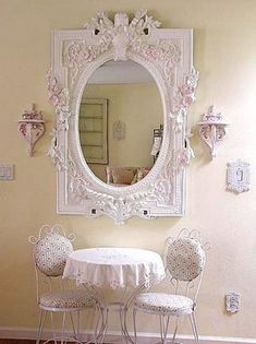 Could find a cool mirror like this at a thrift store and paint it white