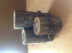 Candle centre piece ... Made from old fence post and barbed wire. ( no link)