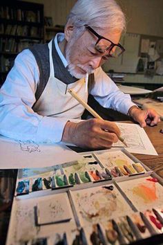 Hayao Miyazaki (宮崎 駿 Miyazaki Hayao, born January 5, 1941 is a Japanese film director, producer, screenwriter, animator, author, and manga artist, here working in his art studio #workspace.