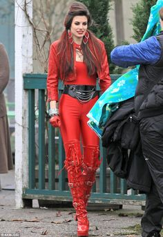 Meghan on set.. That is A LOT of red, but she can rock it!