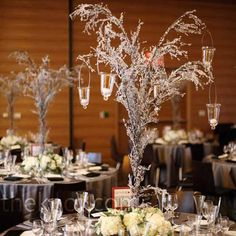 Icicle trees on each of the tables turned the reception into a winter wonderland. Roses, hydrangeas, stock, and seeded eucalyptus added interest at guests' eye level.