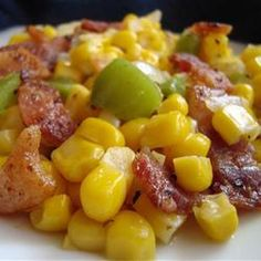Skillet Fried Corn | Corn, green peppers, and onions are fried with bacon for an easy and delicious side dish.