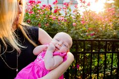 A portrait of a mother and her newborn daughter in the rose garden at sunrise. Photographed by Steadfast Studio.