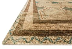 Nomad Aqua Beige Rug Western Rugs - Featuring rich colors, ethnic patterns and an earthy 100% jute fiber, the Nomad rug from India pays homage to tribal design while updating the look for todays interiors. The thick, hand knotted pile and bold design make for an eye catching centerpiece in any room.