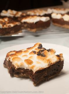 Just looking at these Ooey Gooey S'mores Brownies will make your mouth water. These gluten free brownies are moist, chocolatey, and a little bit sticky. You won't mind making a marshmallow mess because this brownie recipe is unlike any other dessert recipe you've ever tried.