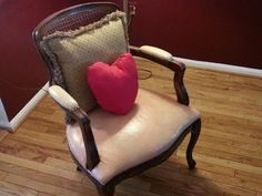Pink Leather Chair with Wood Frame and Heart Shaped Pillow.