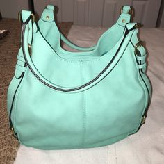 Purse adorable teal colored purse. Great summer color. Never used. Gold hardware. 1 center zipper closure with 2 snap closures. Merona Bags Shoulder Bags