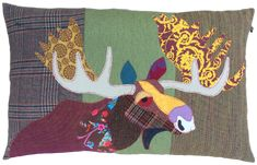 Moosecushion, large 50 x 75 cm, made with a combination of vintage and modern upholstery fabrics.  The Moose is made out of precisely cut out pieces of fabric to create its character, and topstitched in red.  With mole grey cotton/linen backing. Includes 50...