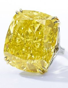 THE GRAFF VIVID YELLOW - Sotheby's. This canary-color jewel originating in South Africa and mounted as a ring, the 100-carat stone sold for $14.2 million.