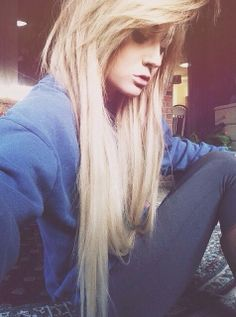 Straight, long blonde locks and heavy side swept bangs.