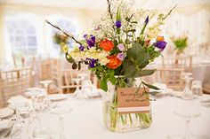 Marquee decorated with informal sprigs of flowers in simple bottles hanging on the marquee wall. Marquee Hire, Marquee Wedding, Flower Decorations, Table Decorations, Hanging Flowers, Brighton, Simple, Wall, Home Decor