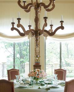 Traditional Setting  Soft greens set the scene for a elegant daytime luncheon. Designed by Michael White.