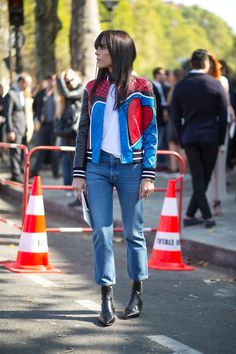 Boyfriend jeans - ankle grazer & above. Boots up to line. Red of jacket - emphasis on shoulders.